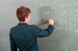 teen solving mathematical problem