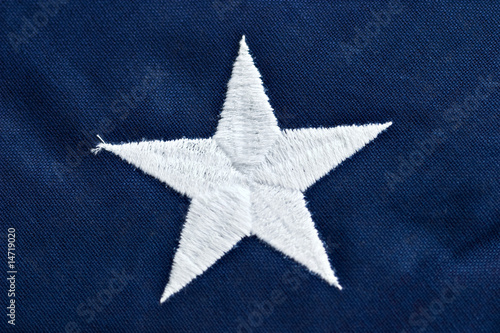 Close up of a star on an American flag.
