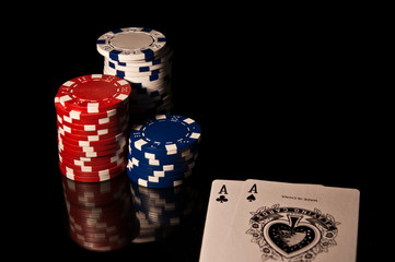 Casino Chips red and black and white and cards