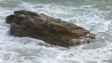 Sea waves against rocks in the beach
