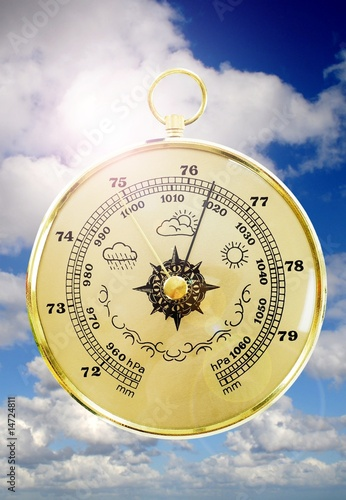 Barometer with cloudy sky in the background - 14724811