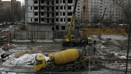 Machine mixer on construction site. Time lapse