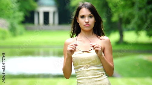 HD720p Young sexy fashion woman outdoor in the garden looking