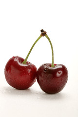 two fresh cherries with water drops