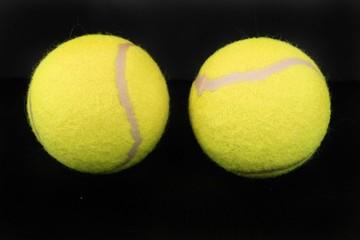 Two yellow tennis balls