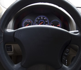 Illuminated dashboard and steering wheel of a modern car