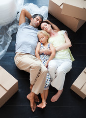 Parents and daughter sleeping on the floor