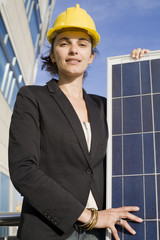 Young woman touching a solar panel