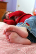 selective focus of little girl's small bare feet