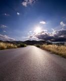 asphalt of country road in backlit poster