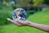 Hand holding a globe. Save Earth Environment poster