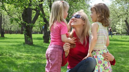 ma and girls in park