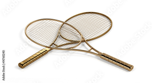 Two gold tеnnis rackets. This image contains clipping path.
