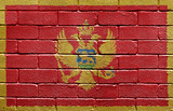 Flag of Montenegro on brick wall poster