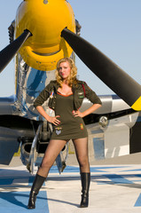 army pinup standing in front of an aircraft