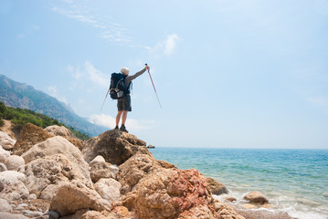 Hikers on a stony sea shore