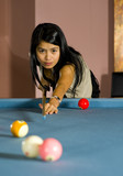 pretty asian woman playing pool