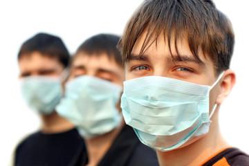 three teenagers in the flu mask