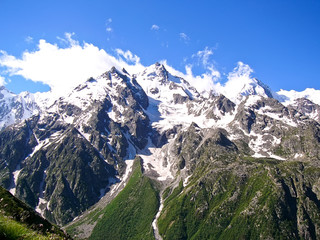 High mountains with snow in summer