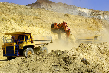 Loading of dump-body trucks in career