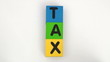 Alphabet blocks spell out TAX series - HD