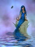Blue Mermaid Sitting On A Pedastel In The Ocean