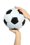 black and white Soccer ball in hands on a white background