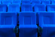 Dark blue rows of theater seats