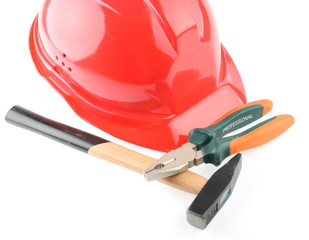 helmet and hammer and combination pliers