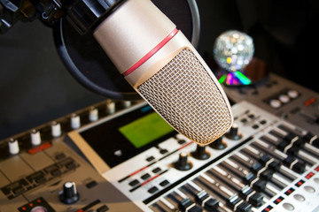 Recording studio with sound equalizer and microphone