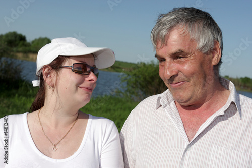 Portrait of couple in a park in summer