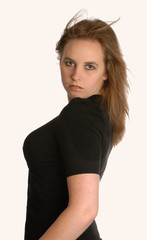 beautiful young woman in black with hair blowing