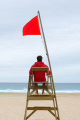 Lifeguard sitting in his chair
