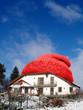 Haus mit Wollmütze für Energiepass