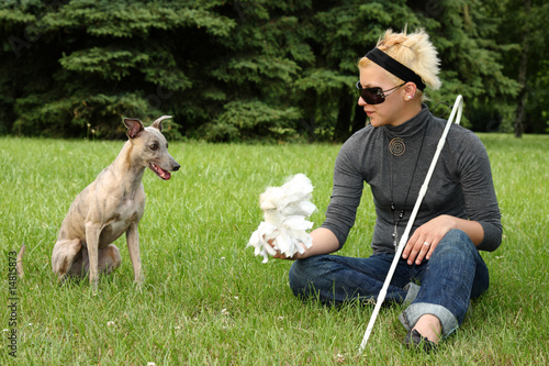 blind woman playing with her dog
