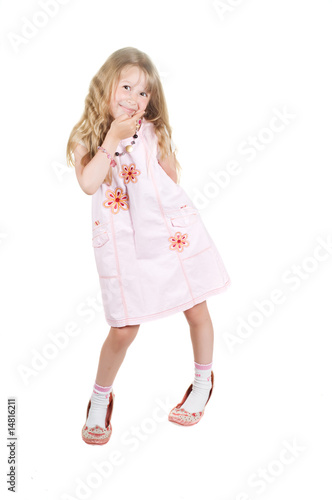 Little girl playing with big mom shoes
