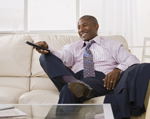 Attractive African American Man watching TV
