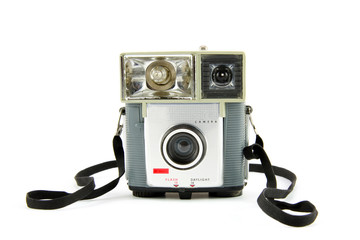 Old fashioned photo camera isolated on white background