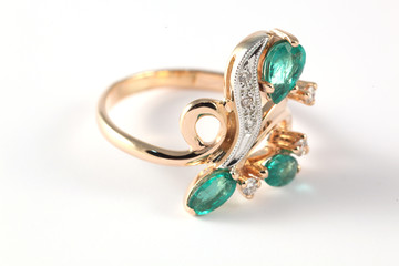 golden ring with diamonds and emerald