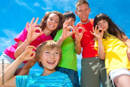 Children showing ok sign