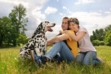 loving couple with a Dalmatian outdoors poster