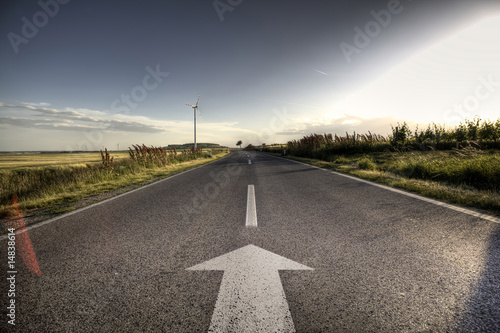Wall mural Country Asphalt road in strong flare