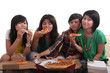 Group of young woman sitting and eating pizza