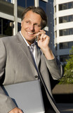 happy smiling businessman using cellphone.
