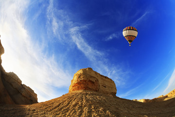 The balloon above mountains of the Dead Sea. A sunset