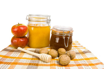 honey jar and apple isolated on the white background