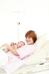 Mother embracing her newborn baby with copy-space