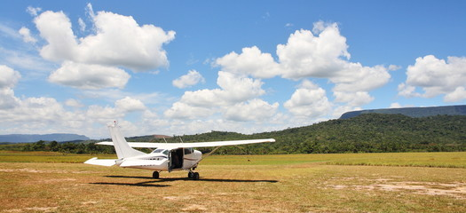 Cessna plane on the unpaved airfield