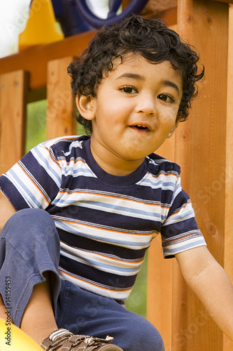 Closeup of a Happy Toddler in a Playset