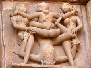 Stone carved erotic sculptures in hindu Khajuraho temple, India
